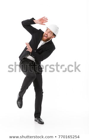 Full length image of Scared business man in protective helmet Stock photo © deandrobot