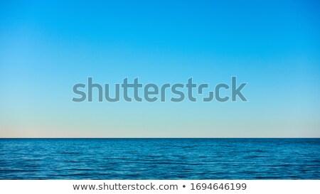 Calm blue sea and clear sky Stock photo © vapi