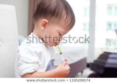 Nino bebé nino medicina jarabe ilustración Foto stock © lenm