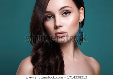 Woman with feather over eyes Stock photo © IS2
