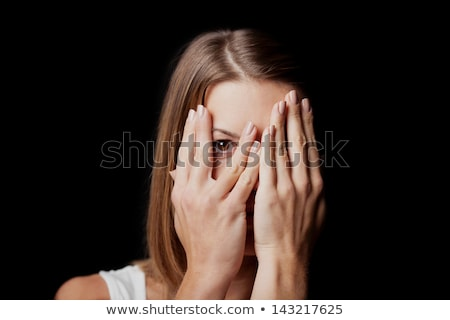 Portrait of a frightened woman holding hands at her face Stock photo © deandrobot
