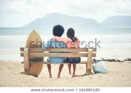 Couple sitting on surfboards Stock photo © IS2