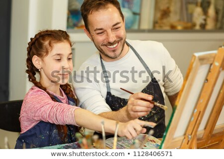 Little girl and man drawing a picture Stock photo © IS2