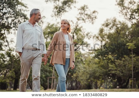 Couple walking woman holding flowers Stock photo © IS2