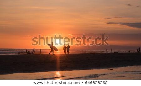 Surfing on Bali at sunset Stock photo © joyr
