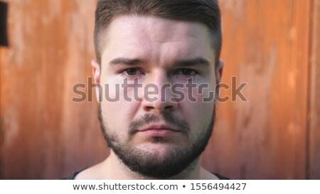 Retrato pensativo joven mirando cámara aislado Foto stock © deandrobot