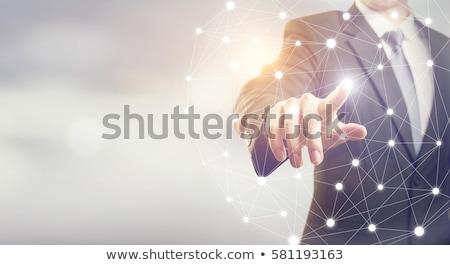 businessman hand connecting to virtual network stock photo © dolgachov