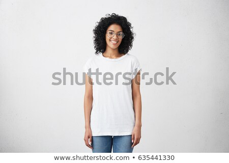 Portrait of a pensive young girl standing isolated Stock photo © deandrobot