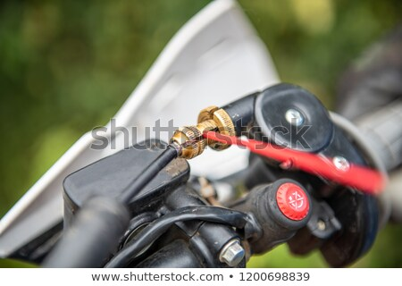 Lubricating motorcycle braking cables Stock photo © homydesign