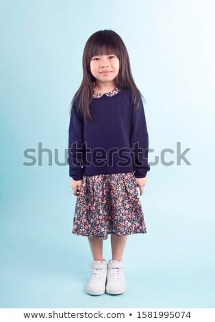 Portret radosny młoda dziewczyna sukienka stałego szary Zdjęcia stock © deandrobot