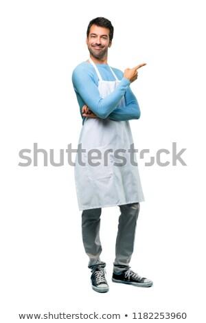 Feliz moço chef cozinhar avental em pé Foto stock © deandrobot