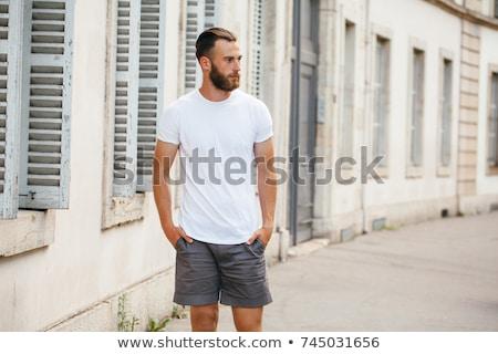 Portret szczęśliwy młodych brodaty człowiek tshirt Zdjęcia stock © deandrobot