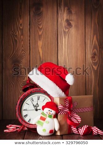 Christmas gift box and alarm clock Stock photo © karandaev