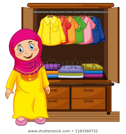 Stock photo: A muslim girl in front of closet