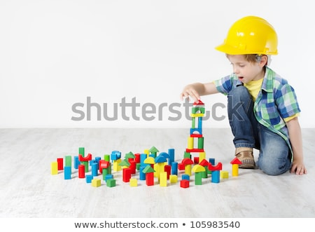 Boy building with blocks sit on the floor stock photo © Lopolo