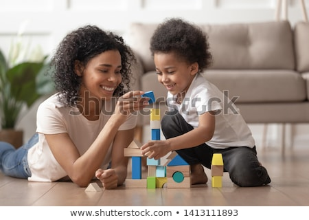 Mother and child boy building from toy blocks at home stock photo © Lopolo