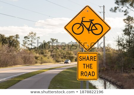 shared lane and beware bike warning sign Stock photo © galitskaya
