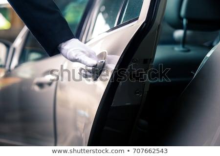 Hand opening auto deur grijs straat Stockfoto © AndreyPopov