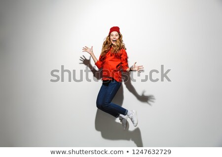 full length photo of brunette woman 20s wearing red clothes laug stock photo © deandrobot