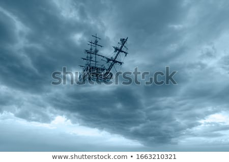Ship sailing in the sea and balloons flying in sky Stock photo © colematt