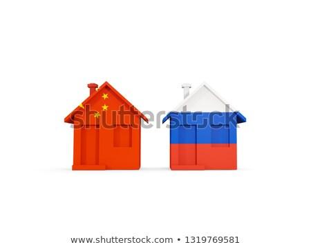 Dos casas banderas Rusia China aislado Foto stock © MikhailMishchenko