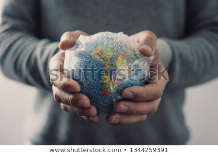 man with a world globe wrapped in bubble wrap Stock photo © nito