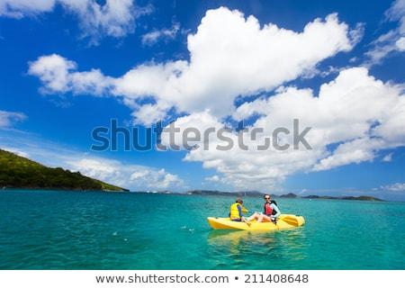 Mother and son kayaking at tropical ocean. Stock photo © galitskaya