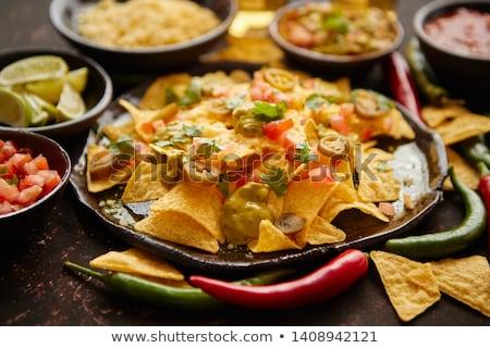 Fresh yellow corn nacho chips on ceramic plate Stock photo © dash