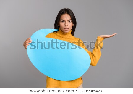 Confundirse mujer posando aislado gris pared Foto stock © deandrobot
