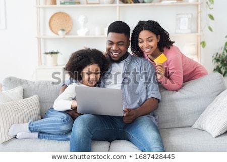 матери · диван · домой · используя · ноутбук · женщину · семьи - Сток-фото © Lopolo