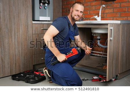 Plumber Assembling The Kitchen Sink Faucet Stock photo © AndreyPopov