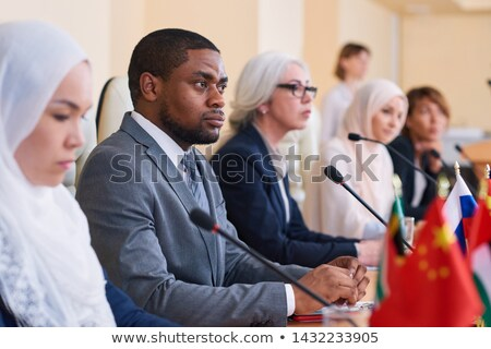 African-american businessman listening attentively to one of speakers report Stock photo © pressmaster