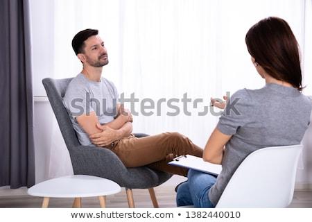 Mann Sitzung Stuhl Psychologe junger Mann weiblichen Stock foto © AndreyPopov