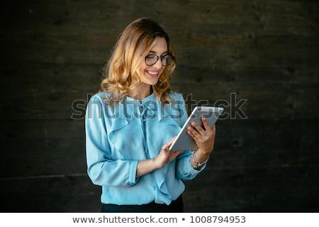 Atraente mulher jovem leitura comprimido sorrir Foto stock © Giulio_Fornasar