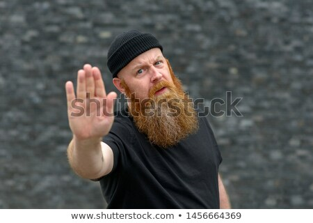 Fed up man holding up his hand in a stop gesture Stock photo © Giulio_Fornasar