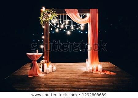 Noche guirnalda bombillas velas vidrio Foto stock © ruslanshramko