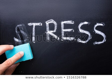 Hand Removes From The Slate The Word Stress Stock photo © AndreyPopov