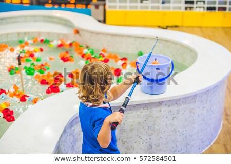 Cute boy in the playroom fishing. The development of fine motor concept. Creativity Game concept Stock photo © galitskaya