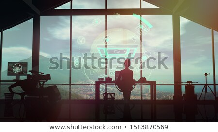Female videographer silhouette at work on infographic background Stock photo © ConceptCafe