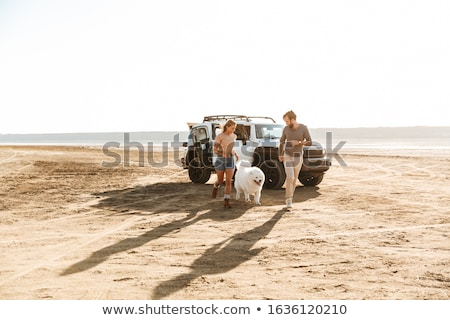 pleased positive young amazing loving couple with dog stock photo © deandrobot
