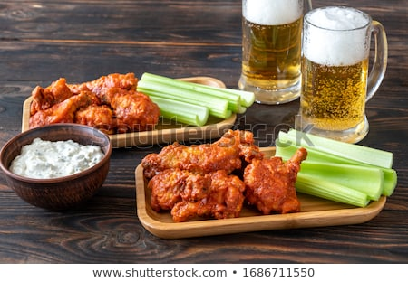 Bowl of buffalo wings with blue cheese dip Stock photo © Alex9500