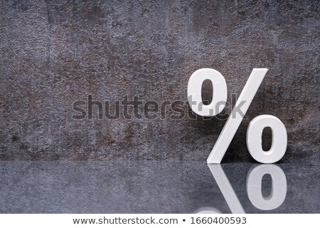 Percentage Sign Leaning On Dark Wall Stock photo © AndreyPopov