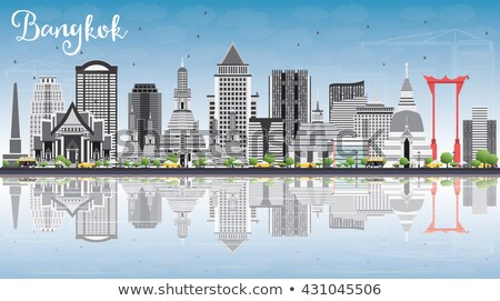 Bangkok Skyline with Gray Landmarks, Blue Sky and Reflections. Stock photo © ShustrikS