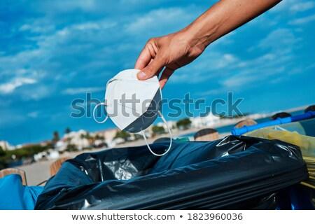 человека используемый маске мусорное ведро пляж Сток-фото © nito