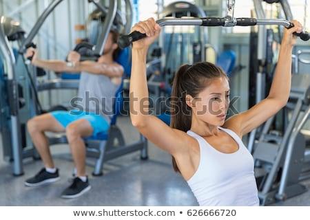 Fitness dziewczyna plecy powrót maszyny Zdjęcia stock © Maridav