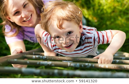 Little boy wanting to climb a tree Stock photo © rcarner