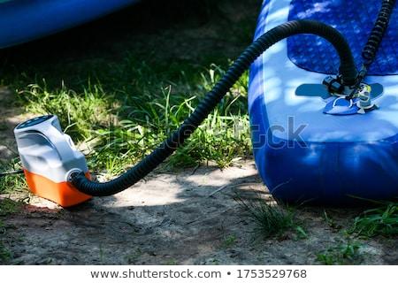 Levegő pumpa férfi használt felfújható játékok Stock fotó © Stocksnapper
