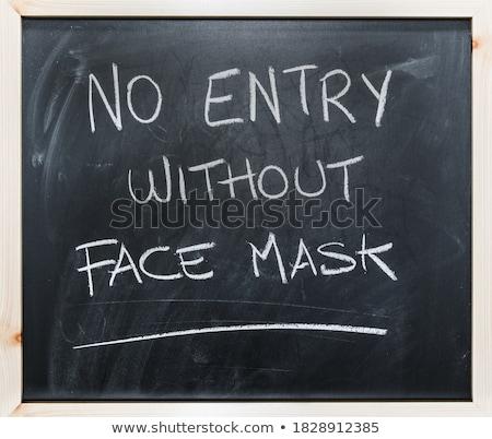 Caution written on blackboard stock photo © bbbar