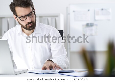 Stock photo: closeup portrait of young man using laptop
