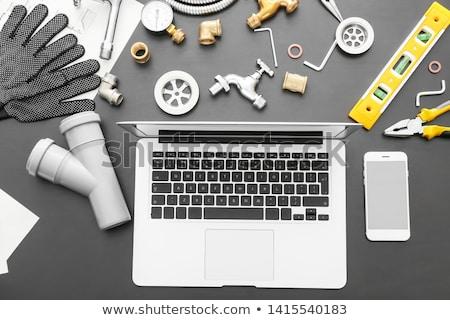 Stock photo: Plumber on laptop
